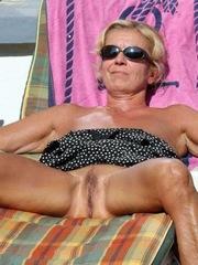 Slender granny sunbathing..