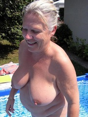 Shapely granny absolutely naked at the pool