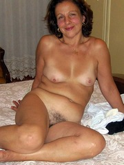 Naughty mature lady naked at..