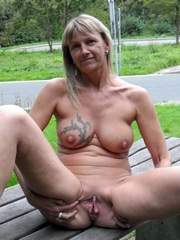 Blonde glam granny show her pussy at the public