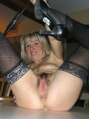 Blonde mature woman show her pussy, astraddle