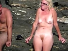 Mature nudist lady on the beach