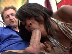 Ebony babe wraps her lips around stud's throbbing cock