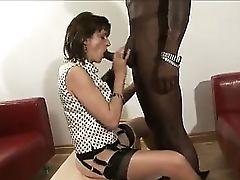 British dame sucks black dick