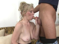 Blonde granny with saggy boobs gets facialized by a stud