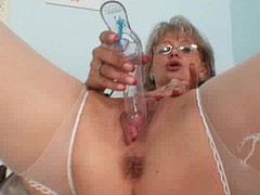 Nasty gray dame over 50 years old works in gynecology room and loves to masturba