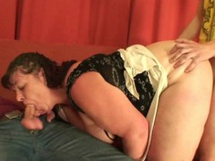 Plump mommy takes two cocks from both sides